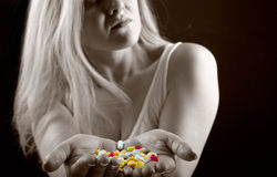 Woman with pills Royalty Free Stock Photos