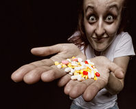 Woman with pills Stock Photo