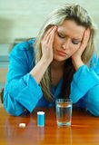 Woman with pills Stock Images