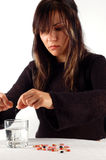 Woman with pills #4 Stock Image