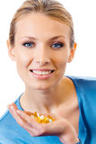 Woman with pills and capsules Stock Images