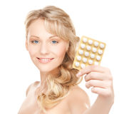 Woman with pills Royalty Free Stock Photo