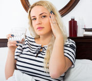 Woman with pills suffering Royalty Free Stock Photography