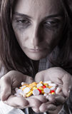 Woman with pills Royalty Free Stock Images