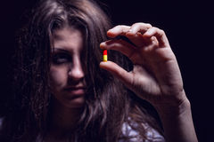 Woman with pills Royalty Free Stock Photography