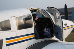 Woman pilot in the aircraft Royalty Free Stock Images