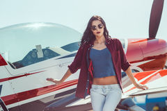 Woman pilot and airplane Royalty Free Stock Image