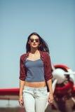 Woman pilot and airplane Stock Photos