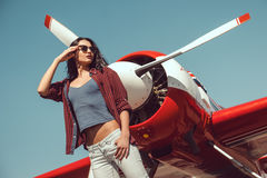 Free Woman Pilot And Airplane Royalty Free Stock Image - 89493226