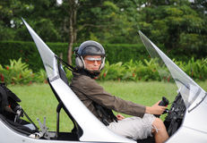 Woman pilot in the autogyro. Woman pilot sitting in the autogyro Royalty Free Stock Images