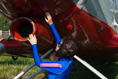 Woman pilot check airplane before flying Stock Images