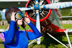 Woman pilot in helmet on background of airplane Royalty Free Stock Photography