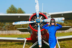 Woman pilot in helmet standing with airplane outdoors Royalty Free Stock Images