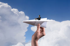 Woman pilot in paper plane. Mixed media Stock Photos