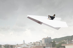 Woman pilot in paper plane. Mixed media Stock Image