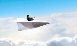 Woman pilot in paper plane. Mixed media Royalty Free Stock Photo