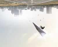 Woman pilot in paper plane. Mixed media Royalty Free Stock Photography