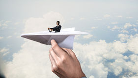 Woman pilot in paper plane. Mixed media . Mixed media Royalty Free Stock Image