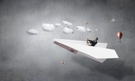 Woman pilot in paper plane. Mixed media . Mixed media Royalty Free Stock Photography