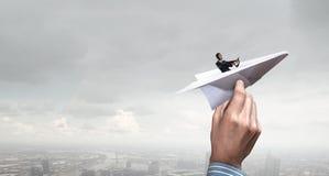 Woman pilot in paper plane. Mixed media . Mixed media Stock Photo