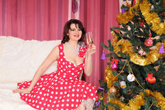 Woman pin-up with champagne Royalty Free Stock Photography