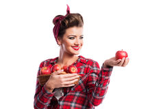 Woman, pin-up hairstyle holding basket with apples. Autumn harve Stock Photography