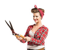 Woman with pin-up make-up and hairstyle holding pruning shears Royalty Free Stock Image