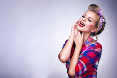 Woman with pin-up make-up and hairstyle posing Stock Photos