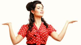 Woman pin-up make-up hairstyle posing in studio Stock Photos