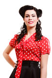 Woman pin-up make-up hairstyle posing in studio Royalty Free Stock Image