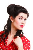 Woman pin-up make-up hairstyle posing in studio Stock Image