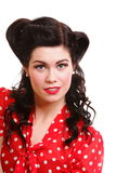Woman pin-up make-up hairstyle posing in studio Stock Images