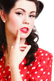 Woman pin-up make-up hairstyle posing in studio Stock Photography