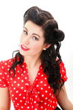 Woman pin-up make-up hairstyle posing in studio Stock Photo