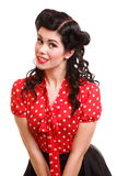 Woman pin-up make-up hairstyle posing in studio Royalty Free Stock Photography