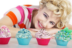 Woman in pin up style and cupcake Stock Image