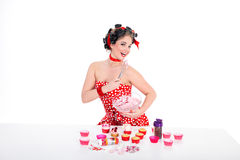 Woman in pin up style and cupcake Stock Photos