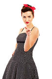 Woman in Pin-up style pointing at you Stock Photo