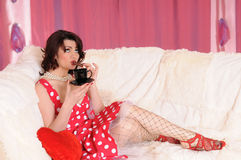 Woman pin-up with tea Royalty Free Stock Images