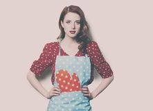 Woman in pinafore with potholder Royalty Free Stock Photo