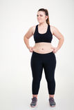 Woman pinches fat on her belly Stock Photography