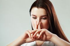 Woman pinches nose Royalty Free Stock Photos