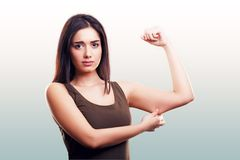 Woman pinching flabby fat arm skin royalty free stock photography