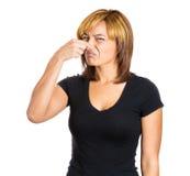 Woman pinching nose Royalty Free Stock Photography