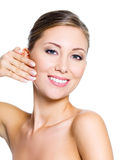 Woman pinching skin on her cheek Stock Image