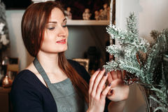 Woman with pine branch Stock Images