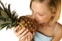 Woman with pineapple Stock Photography