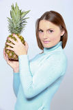 Woman with pineapple Royalty Free Stock Photography