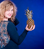 Woman with pineapple Stock Photos