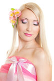 Woman in pink. Beautiful woman in pink looking down Stock Image